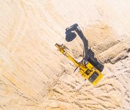 Excavator in the mine or construction site. Royalty Free Stock Photography