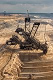 Excavator Mining In A Brown Coal Open Pit Mine. Bucket-wheel Excavator Mining In A Brown Coal Open Pit Mine royalty free stock photo