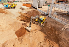 Excavator on Modern factory construction site Stock Photos