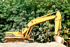 Excavator on a mound Royalty Free Stock Images