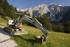 Excavator in the mountains Royalty Free Stock Photography
