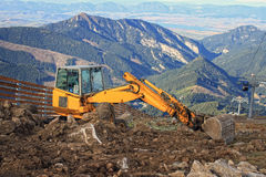 Excavator in Mountains Royalty Free Stock Photo