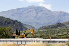 Excavator in the mountains Royalty Free Stock Photos