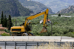 Excavator in the mountains Royalty Free Stock Image