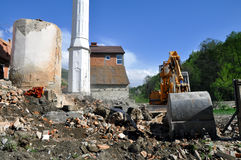 Excavator moving soil and sand on construction site. Industrial excavator moving soil and sand on construction site Stock Image