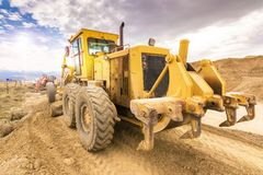 Excavator moving stone in an open pit mine in Spain royalty free stock photography