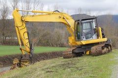 Excavator Mulching Wild Growth Stock Photos