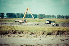 Excavator on new construction site Stock Image