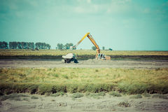 Excavator on new construction site Royalty Free Stock Photo