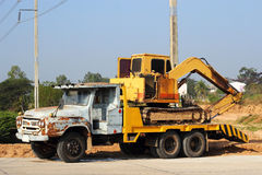 Excavator on old truck Royalty Free Stock Photo