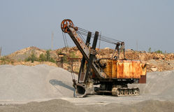 Excavator in an opencast mine Stock Images