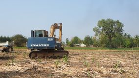 An excavator operates on an agricultural land stock video