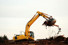 Excavator. Operating in construction site Royalty Free Stock Photography
