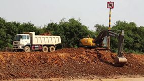Excavator operation near riverbank of Tonle Sap lake in Cambodia stock footage