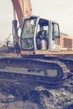 Excavator operator in cab. BELGRADE, SERBIA - DECEMBER 17, 2015: Excavator operator in cab at workplace. Man operating excavator at building site. Selective Stock Image