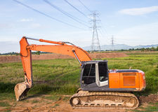 Excavator orange machinery, in the construction site Stock Photo