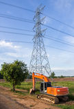 Excavator orange machinery, in the construction site Stock Photo