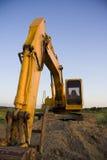 Excavator overlooking farmland Stock Photography