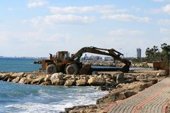 An excavator on the Limassol seafront royalty free stock photography
