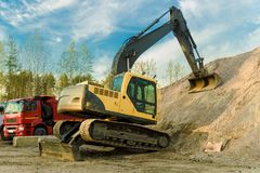 The excavator is parked after a hard day stock photos