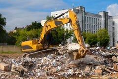 Excavator parses trash. Excavator works in demolition and clean-up of debris Stock Photo