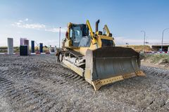 Excavator performing earthworks work in the expansion works of the Madrid-Segovia-Valladolid highway royalty free stock photography