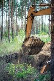 Excavator performs excavation work by digging the ground with a bucket royalty free stock image
