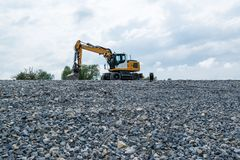 Excavator and plane Royalty Free Stock Photography