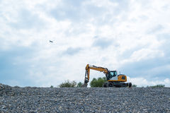 Excavator and plane Royalty Free Stock Photos