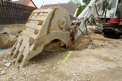 Excavator ploughshare on trench - constructing canalization Stock Images
