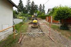Excavator ploughshare on trench - constructing canalization Stock Photo