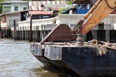 Excavator on pontoon Royalty Free Stock Photos