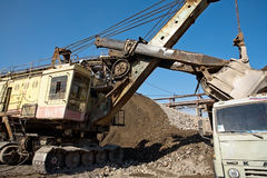 Excavator pours rubble into a truck Royalty Free Stock Photos