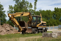 Excavator; power shovel; steam shovel; earth-moving mashine; dre. Excavator; power shovel; dredge standing on the ground Stock Photos