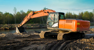 Excavator produces sand in a quarry Stock Photo