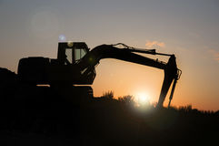 Excavator. Profile digging for the sun Royalty Free Stock Photography