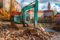 Excavator putting stones to the truck Stock Image