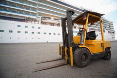 Excavator in Qaboos port. Stock Photos