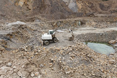 Excavator in a quarry. Distant view Royalty Free Stock Photography