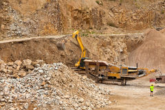 Excavator at Quarry site Stock Image
