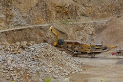 Excavator at Quarry site Royalty Free Stock Images