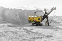 Excavator in a quarry Stock Images