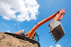 Excavator with raised bucket Royalty Free Stock Images