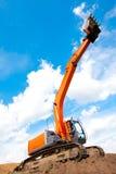 Excavator with raised bucket Royalty Free Stock Image