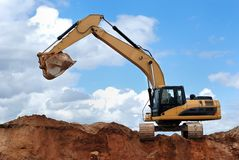 Excavator with raised bucket Royalty Free Stock Image