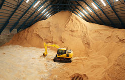 Excavator in a raw sugar storage Royalty Free Stock Photos