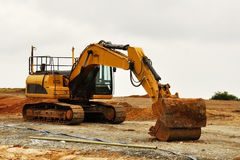 Excavator in red soil Stock Image