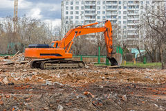 Excavator removes construction waste after building demolition Stock Photography
