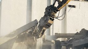 Excavator removing remains of house ruined by natural disaster or terror attack. Stock footage stock video