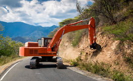 Excavator repair the road. Royalty Free Stock Images